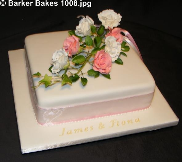 wedding cake with sugar flowers made out of Barker Bakes Flowerpaste